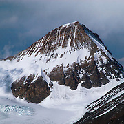 Kellas Rock Peak, a 7,071 meter peak named after famed climber and physiologist Dr. Alexander Kellas, rises high above the East Rongbuk Glacier of Mount Everest as viewed from the North Col. Kellas was a member of the 1921 Everest Reconnaissance Expedition, but died from dystentery at Khampa Dzong, Tibet, en route to the mountain. The peak was named and climbed that year by George Mallory.