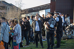© Licensed to London News Pictures. 04/04/2021. London, UK. Police try to disperse crowd of revellers by the canal on Easter Sunday in Hackney Wick, east London. Photo credit: Marcin Nowak/LNP