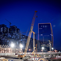 Baku, Azerbaijan, 26 July 2012<br /> Night view of a site where new buildings are under construction.<br /> Baku is the capital and largest city of Azerbaijan, as well as the largest city on the Caspian Sea and of the Caucasus region.<br /> It is located on the southern shore of the Absheron Peninsula, which projects into the Caspian Sea.<br /> The city consists of two principal parts: the downtown and the old Inner City (21.5 ha).<br /> Baku's urban population at the beginning of 2009 was estimated at just over two million people. Officially, about 25 percent of all inhabitants of the country live in the metropolitan city area of Baku.<br /> Photo: Ezequiel Scagnetti