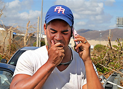 Carlos Rolâ¤â€n, a financial planner from the town of San Lorenzo, stop along the Caguas road to call his relatives in Orlando Florida to communicate to them his decision to leave Puerto Rico with his family on October 2. It is a decision against their will since their house got damaged, he is jobless and their daughters' schools are closed for an unknown amount of time forcing many Puerto Ricans to fly to the U.S. after Hurricane Maria, (category 4) passed through Puerto Rico devastating the island leaving residents without power and ways to communicate on Sept. 20. on October 02, 2017. Photo by Pedro Portal/Miami Herald/TNS/ABACAPRESS.COM