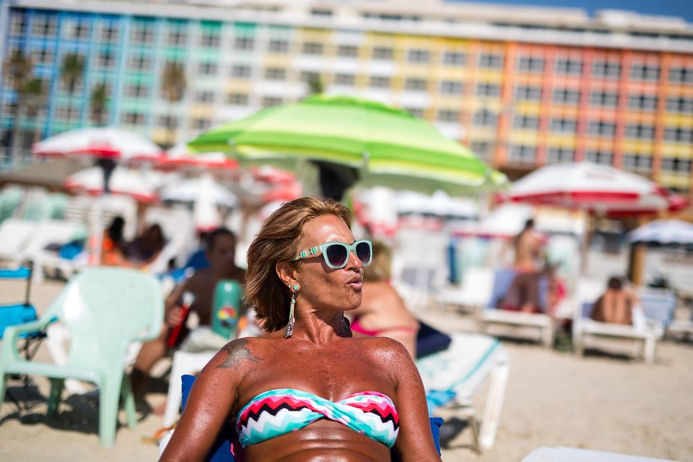 Ruth Bar sunbathes at Frishman Beach in Tel Aviv, Israel, on July 21, 2015.