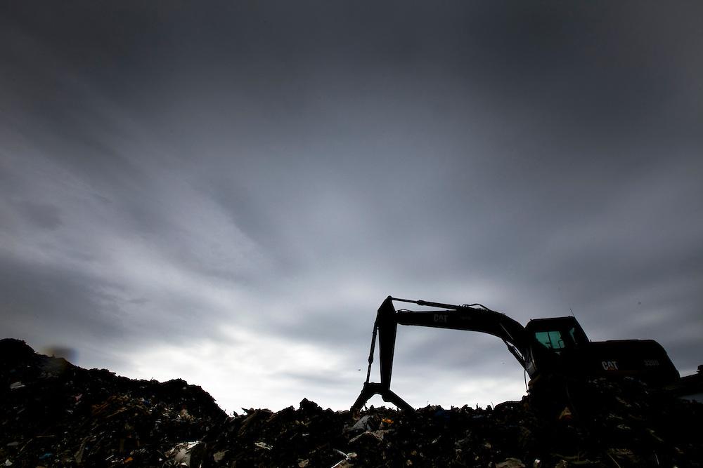 A loading shovel works on heaped wreckage         in Ishinomaki city.