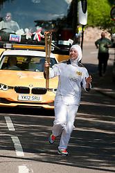 Olympic Torch reaches Sheffield Chapeltown/Ecclesfield/Parson Cross leg.<br /> Torch bearer 101 Dana Abdulkarim brings the Torch closer to Chapeltown<br /> 25 June 2012.Image © Paul David Drabble