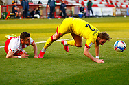 Cameron Norman of Walsall goes over during a tight tackle with Stevenage player during the EFL Sky Bet League 2 match between Stevenage and Walsall at the Lamex Stadium, Stevenage, England on 20 February 2021.