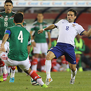 João Moutinho, (right), Portugal, is challenged by Rafael Márquez, Mexico, during the Portugal V Mexico International Friendly match in preparation for the 2014 FIFA World Cup in Brazil. Gillette Stadium, Boston (Foxborough), Massachusetts, USA. 6th June 2014. Photo Tim Clayton