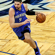 ORLANDO, FL - MARCH 01: Nikola Vucevic #9 of the Orlando Magic drives to the net against the Dallas Mavericks during the first half at Amway Center on March 1, 2021 in Orlando, Florida. NOTE TO USER: User expressly acknowledges and agrees that, by downloading and or using this photograph, User is consenting to the terms and conditions of the Getty Images License Agreement. (Photo by Alex Menendez/Getty Images)*** Local Caption *** Nikola Vucevic