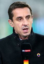 Sky Sports pundit wears a stonewall pin badge and uses a rainbow coloured microphone in association with charity Stonewall