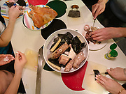 Various arctic food including: killer whale intestine filled with killer whale blubber, dried seal meat, killer whale skin and blubber (called Maatak), boiled seal meat, dried salmon, polar bear meat.<br /> Diner at the house of hunters Bent and Dina Igniatiussen. Life in and around the small Inuit settlement of Isortoq (population of 64), in East Greenland.
