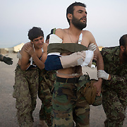 Afghan soldiers are led to waiting US medevac helicopters after they were injured by a roadside bomb set by insurgents in Maiwand District, Kandahar, Afghanistan. The majority of military related casualties are suffered by Afghan soldiers. (Credit Image: © Louie Palu/ZUMA Press/The Alexia Foundation).....
