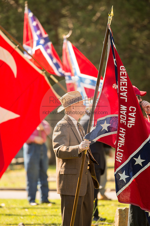 Civil war descendants in gather holding flags during a service at Elmwood Cemetery to mark Confederate Memorial Day May 2, 2015 in Columbia, SC. Confederate Memorial Day is a official state holiday in South Carolina and honors those that served during the Civil War.