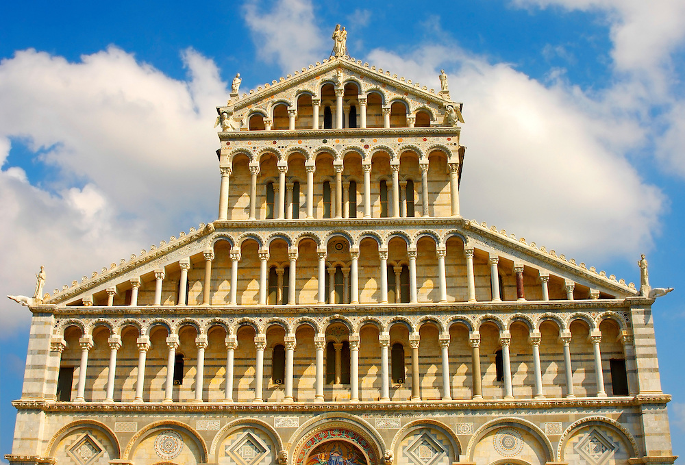 Catherderal - Piazza  del Miracoli - Pisa - Italy . Pisa Cathedral is a medieval Roman Catholic cathedral dedicated to the Assumption of the Virgin Mary, in the Piazza dei Miracoli in Pisa, Italy. It is a notable example of Romanesque architecture, in particular the style known as Pisan Romanesque.It is the seat of the Archbishop of Pisa. Construction on the Pisa cathedral began in 1063, in the early 12th century the cathedral was enlarged under the direction of architect Rainaldo.