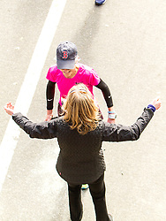 ING New York City Marathon: Joan Benoit Samuelson, 56, finishes race in 2:57:13, wearing trademark Boston Red Sox cap, is greeted with open arms by race director Mary Wittenberg