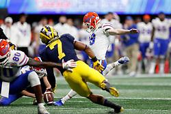 Florida Gators quarterback Jack Ruskell #19 kicks a field goal during the Chick-fil-A Peach Bowl, Saturday, December 29, 2018, in Atlanta. ( Paul Abell via Abell Images for Chick-fil-A Peach Bowl)
