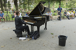 August 19, 2017 - New York, New York, United States - New Yorkers enjoy performance by Colin Huggins on piano which kills fascists on beautiful Saturday in Washington Square park (Credit Image: © Lev Radin/Pacific Press via ZUMA Wire)