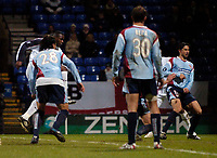 Photo: Jed Wee.<br /> Bolton Wanderers v Sevilla. UEFA Cup. 14/12/2005.<br /> <br /> Bolton substitute Bruno N'Gotty (L) prods the ball home after a scramble in the box for the first goal of the game.