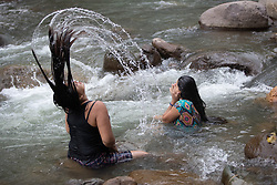 Young women bathe in the Guapinol river, Colón. Members of the Guapinol community have been criminalised and imprisoned for protesting against a massive mining operation that affects the river.