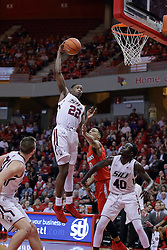22 February 2017:  Armon Fletcher gets high to get the rebound over Phil Fayne(10) and Thik Bol during a College MVC (Missouri Valley conference) mens basketball game between the Southern Illinois Salukis and Illinois State Redbirds in  Redbird Arena, Normal IL