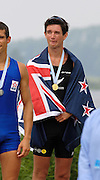 2006, U23 Rowing Championships,Hazewinkel, BELGIUM Sunday, 23.07.2006. NZL BLM1X, Storm URE, drapped in New Zealand flag, listen to the, National Anthem, after winning the men's Senior B, lightweight Single Scull, Photo  Peter Spurrier/Intersport Images email images@intersport-images.com..[Mandatory Credit Peter Spurrier/ Intersport Images] Rowing Course, Bloso, Hazewinkel. BELGUIM