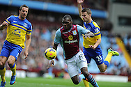 Aston Villa's Christian Benteke is brought down by Everton's Seamus Coleman (r) for a penalty.  Barclays Premier League, Aston Villa v Everton at Villa Park in Aston, Birmingham on Saturday 26th Oct 2013. pic by Andrew Orchard, Andrew Orchard sports photography,
