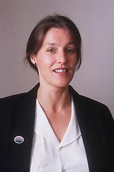 Portrait of woman wearing suit,