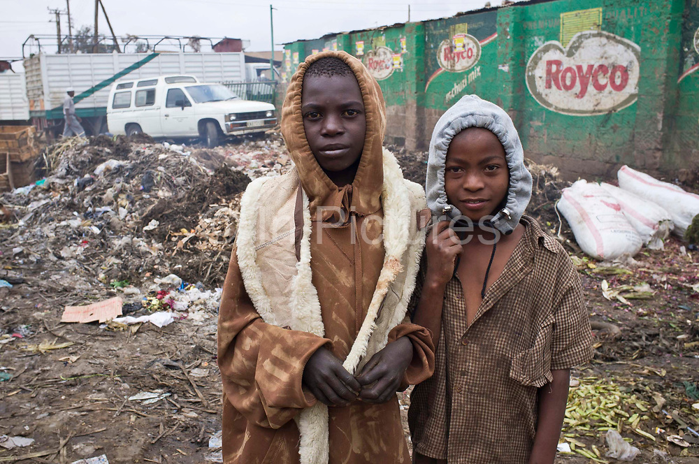 Moriani (15)  and Peter (12) both street boys that work outside the Makongeni market, Thika, Kenya. They are not allowed inside the market during school time as the market manager has banned all children from working during school hours. The market work closely with Afcic, Action for children in conflict, and are trying to encourage the kids to go to school.