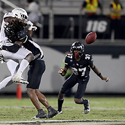 ORLANDO, FL - OCTOBER 03:  Aaron Robinson #31 of the Central Florida Knights breaks up a pass to Sam Crawford Jr. #9 of the Tulsa Golden Hurricane at Bright House Networks Stadium on October 3, 2020 in Orlando, Florida. (Photo by Alex Menendez/Getty Images) *** Local Caption *** Aaron Robinson; Sam Crawford Jr.