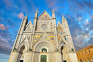 14th century Tuscan Gothic style facade of the Cathedral of Orvieto, designed by Maitani , Umbria, Italy .<br /> <br /> Visit our ITALY HISTORIC PLACES PHOTO COLLECTION for more   photos of Italy to download or buy as prints https://funkystock.photoshelter.com/gallery-collection/2b-Pictures-Images-of-Italy-Photos-of-Italian-Historic-Landmark-Sites/C0000qxA2zGFjd_k<br /> .<br /> <br /> Visit our MEDIEVAL PHOTO COLLECTIONS for more   photos  to download or buy as prints https://funkystock.photoshelter.com/gallery-collection/Medieval-Middle-Ages-Historic-Places-Arcaeological-Sites-Pictures-Images-of/C0000B5ZA54_WD0s