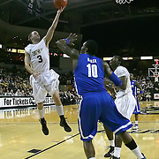Central Florida guard A.J. Rompza (3) drives to the basket against Memphis forward Tarik Black (10) during a Conference USA NCAA basketball game between the Memphis Tigers and the Central Florida Knights at the UCF Arena on February 9, 2011 in Orlando, Florida. Memphis won the game 63-62. (AP Photo: Alex Menendez)