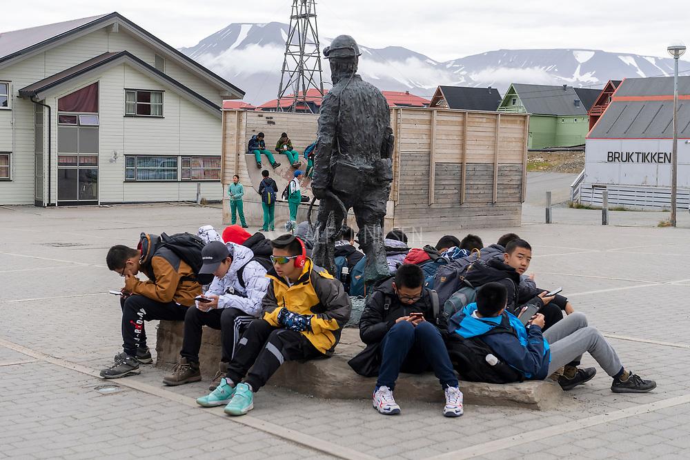 Young tourists enjoying Longyearbyen, Svalbard.