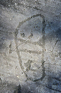 Petroglyph, rock carving, of two feet outlines. Carved by the ancient Camunni people in the iron age between 1000-1200 BC. Foppi di Nadro, Riserva Naturale Incisioni Rupestri di Ceto, Cimbergo e Paspardo, Capo di Ponti, Valcamonica (Val Camonica), Lombardy plain, Italy .<br /> <br /> Visit our PREHISTORY PHOTO COLLECTIONS for more   photos  to download or buy as prints https://funkystock.photoshelter.com/gallery-collection/Prehistoric-Neolithic-Sites-Art-Artefacts-Pictures-Photos/C0000tfxw63zrUT4<br /> If you prefer to buy from our ALAMY PHOTO LIBRARY  Collection visit : https://www.alamy.com/portfolio/paul-williams-funkystock/valcamonica-rock-art.html
