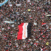 Massive Egyptian flag carried across Cairo's Tahrir Square during the Day of Justice and Cleansing.