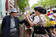"Austrian Drag Queen, Tamara Mascara (right) gives an older Japanese man a ""High Five"" as he shows his support for LGBT issues at the sixth annual Tokyo Rainbow Pride event, Tokyo, Japan. Sunday May 7th 2017. Tokyo's  colourful and energetic Rainbow Pride Week runs from April 29th to May 7th in 2017 with Lesbian, Gay, Bisexual and Transgender (LGBT) awareness raising events throughout the week culminating in the Rainbow Pride Parade on Sunday May 7th."