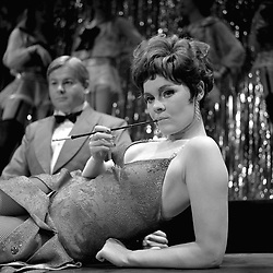 Judi Dench in her provocative role as the amoral Sally Bowles in Cabaret, the new musical show at the Palace Theatre, London.