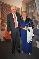 SIR SYDNEY & LADY LIPWORTH at a gala evening in aid of Ubuntu Education Fund held at Battersea Power Station, London on 4th May 2011.
