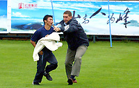 Photo. Sportsbeat Images<br />26/07/2003<br />A fan trys to get to the real madrid players during their training session