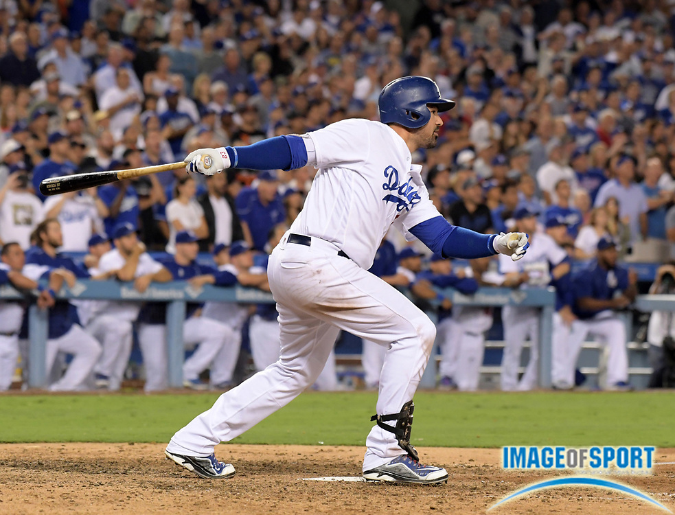 Sep 19, 2016; Los Angeles, CA, USA; Los Angeles Dodgers first baseman Adrian Gonzalez (23) follows through on a walk-off double in the ninth inning in a 2-1 victory over the San Francisco Giants during a MLB game at Dodger Stadium.
