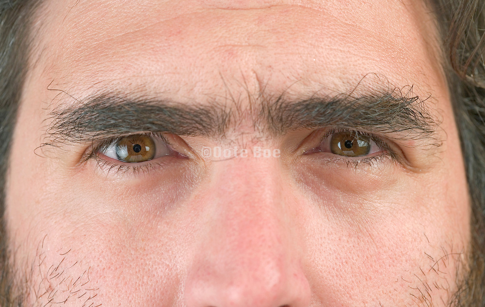 close up of a man's face looking straight at you