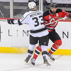 June 9, 2012: Los Angeles Kings defenseman Willie Mitchell (33) and New Jersey Devils left wing Ilya Kovalchuk (17) collide during first period action in game 5 of the NHL Stanley Cup Final between the New Jersey Devils and the Los Angeles Kings at the Prudential Center in Newark, N.J.