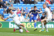 Cardiff's Anthony Pilkington (c) shoots at goal while Bolton's Tyler Garratt (l) and David Wheater try and block the ball. Skybet football league championship match, Cardiff city v Bolton Wanderers at the Cardiff city Stadium in Cardiff, South Wales on Saturday 23rd April 2016.<br /> pic by Carl Robertson, Andrew Orchard sports photography.