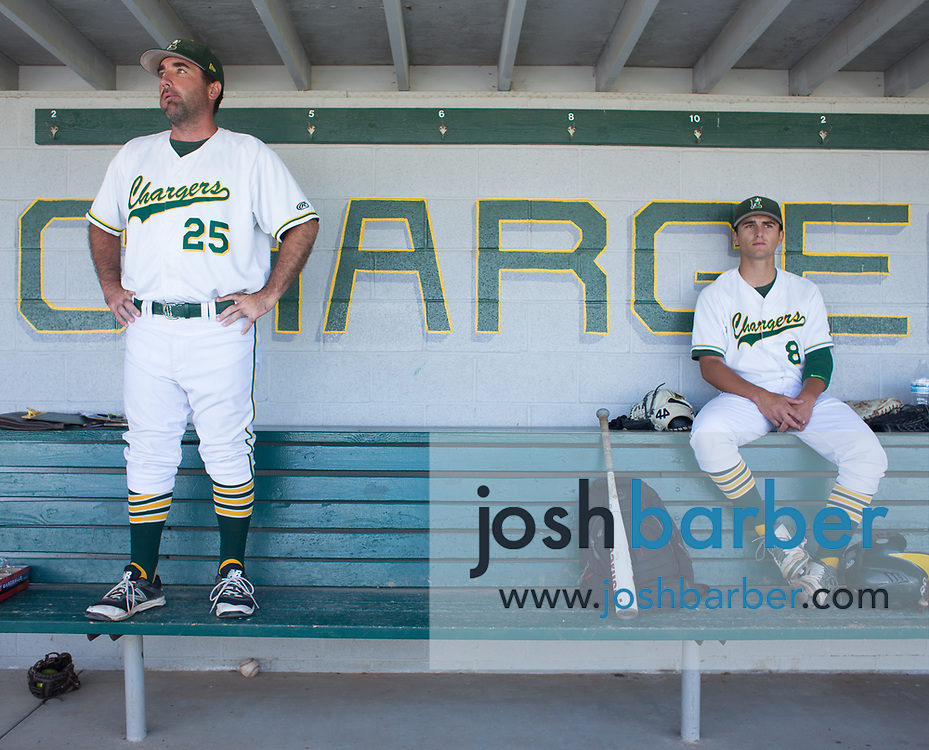 Edison head coach Cameron Chinn  and pitcher Vince Inman (8) watch their team bat from the bench during a CIF-SS Division 2 second round game against Moorpark at Edison High School on Tuesday, May 23, 2017 in Huntington Beach, California. (Photo/Josh Barber)