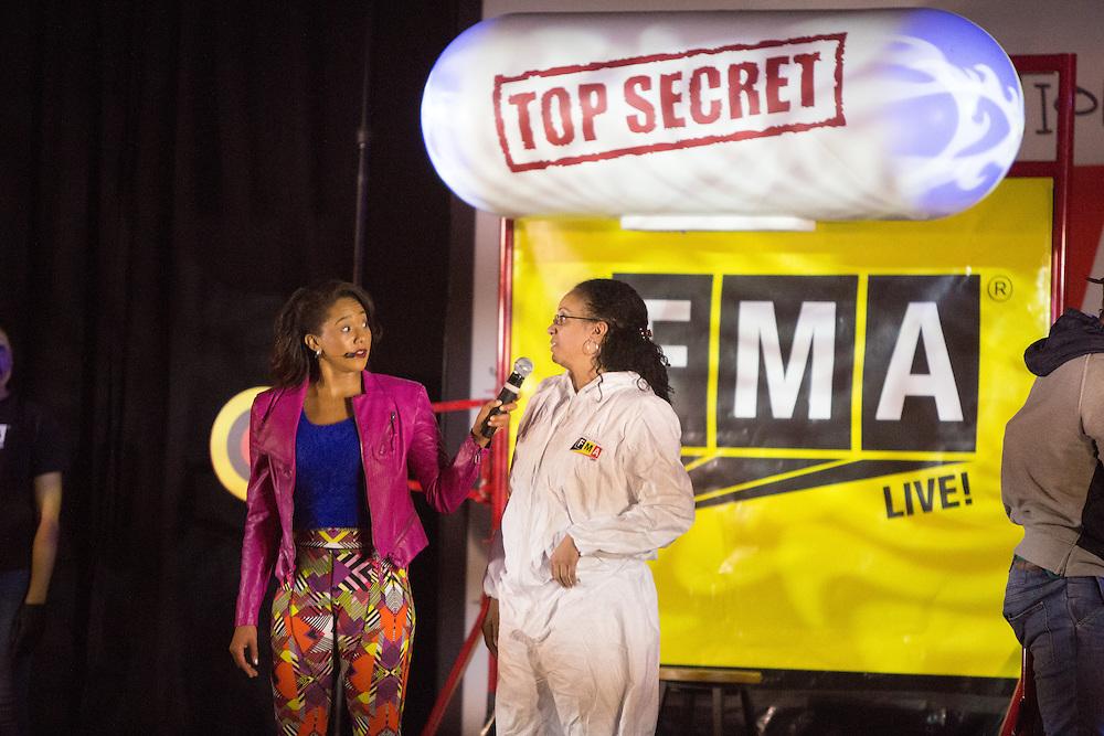 Performer Sharmaine Tate interviews teacher Christine Bright as Honeywell and NASA bring hip-hop physics educational series to the Quitman Street Community School in Newark. <br /> <br /> 3/19/2015 Photo by John O'Boyle<br /> www.johnoboylevisuals.com<br /> john@johnoboyle.com