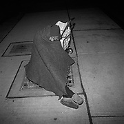 A homeless woman sleeping with her belongings on a heated exhaust vent for an office tower at the corner of Richmond Street West and York Street, located in Toronto's Financial District. This woman has been living on this grate for several years..(Credit Image: © Louie Palu/ZUMA Press)