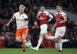 Blackpool's Mark Cullen (left) and Arsenal's Julio Pleguezuelo battle for the ball during the Carabao Cup, Fourth Round match at the Emirates Stadium, London.