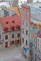 The colorful rooftops of Petit Champlain district in Old Quebec City harken back to European roots. A mural on the side of the building depicts an ancient village.