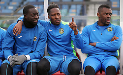 Sutton United's Roarie Deacon (left) sits in the dugout during the training session at Gander Green Lane, London.