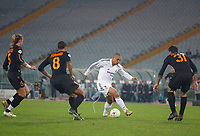 Real Madrid's Ronaldo takes on the Roma defence in an empty Stadio Olympico. Fans were banned after the referee was hit by a missle during a previous Champion's League match.