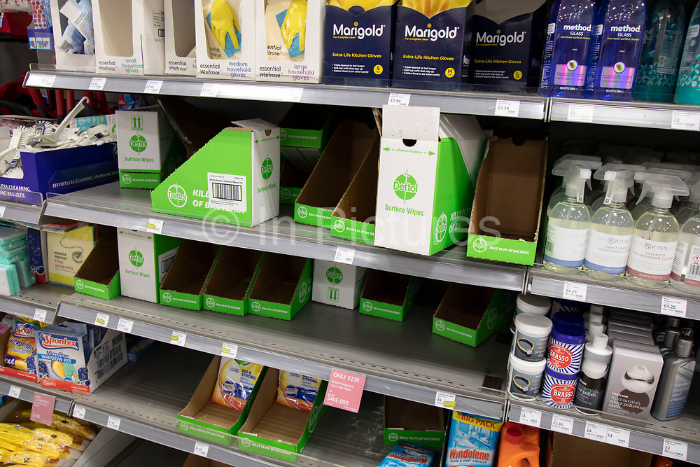 Empty supermarket shelves due to panic buying of essential goods during the coronavirus outbreak on 7th March 2020 in London, United Kingdom. Some customers have started shopping in bulk for certain items to stockpile as the virus continues to spread and the number of cases increases, amid concerns for public health. Here antibaterial wipes have been cleared from the shelf.