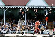 Scottish couple in tartan kilts dancing the sword dance at the Braemar Royal Highland Gathering, the Braemar Games in Scotland