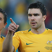 Harry Kewell and Michael Beauchamp (right) during the 2010 Fifa World Cup Asian Qualifying match between Australia and Uzbekistan at Stadium Australia in Sydney, Australia on April 01, 2009. Australia won the match 2-0.  Photo Tim Clayton
