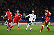 Tom Lawrence of Rotherham Utd looks to break through the Cardiff defence. Skybet football league championship match, Cardiff city v Rotherham Utd at the Cardiff city stadium in Cardiff, South Wales on Saturday 6th December 2014<br /> pic by Andrew Orchard, Andrew Orchard sports photography.